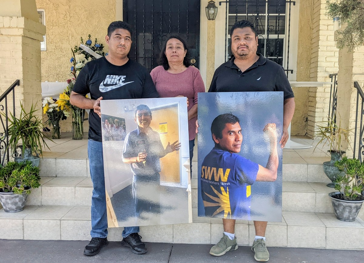 Tomas Mejia's brother, Fermin Pineda, left, wife, Dora Molina, and cousin, David Mejia, stand for a photo outside the home Mejia shared with Molina. Photo by Jacqueline Garcia, La Opinion