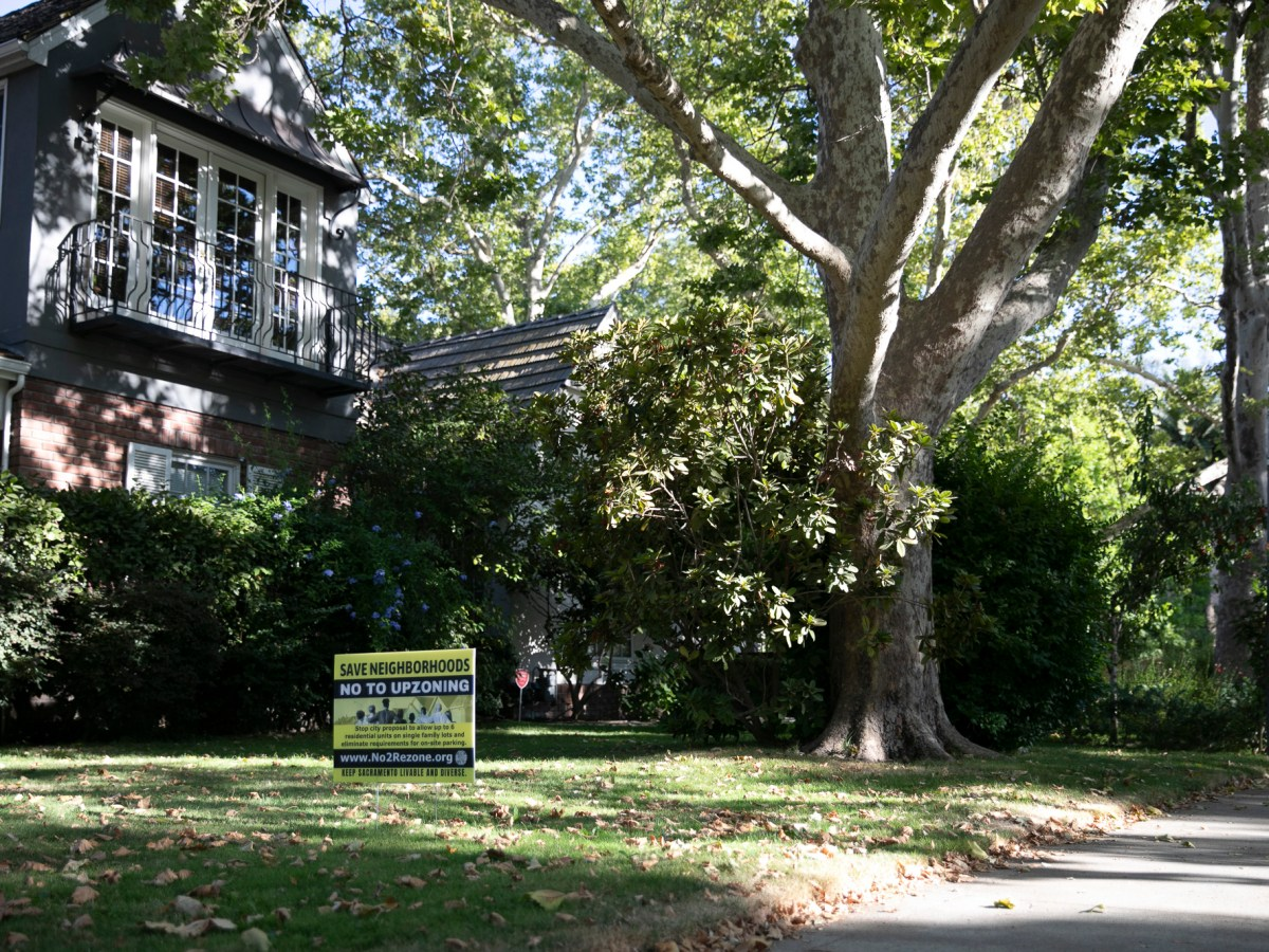 A 'No to upzoning' sign on the lawn of an East Sacramento home on Aug. 4. 2021 symbolizes the debate over a bill to end single-family zoning in California. Photo by Anne Wernikoff, CalMatters