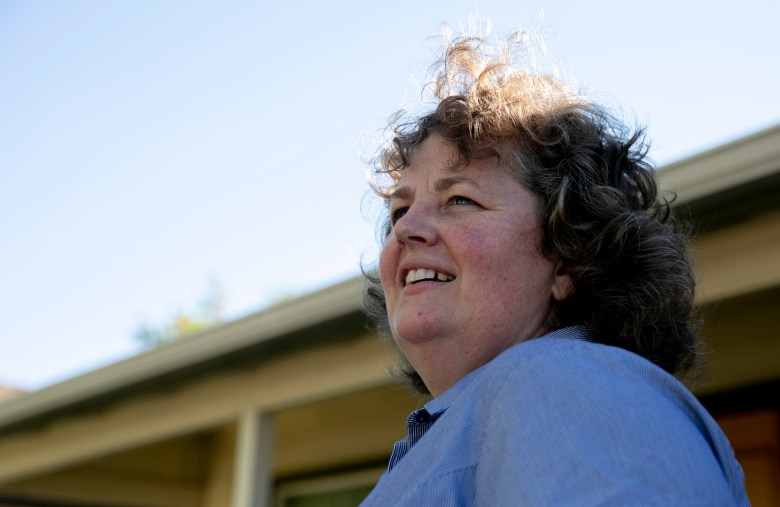 Jennifer Holden, who has owned her Mangen Park bungalow for close to two decades, fears lot splitting will increase property taxes and make home ownership less attainable for middle class buyers. Photo by Anne Wernikoff, CalMatters