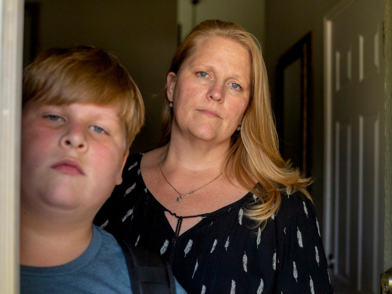 Kayden Christiansen and his mother, Heather Christiansen, at their home in Simi Valley. Kayden, a fifth-grader, was in quarantine for 10 days shortly after his California school reopening. Photo by Shae Hammond for CalMatters