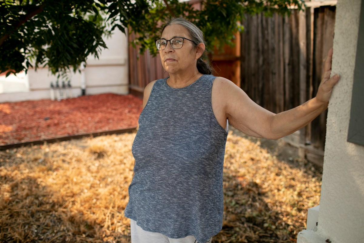 Chris Cummins is photographed outside the home she shares with her daughter and grandchildren in Martinez on. Aug. 27, 2021. Cummins, who is not eligible for Golden State Stimulus payments because she doesn't earn income from work, says she will not vote in the upcoming recall election. Photo by Anne Wernikoff, CalMatters