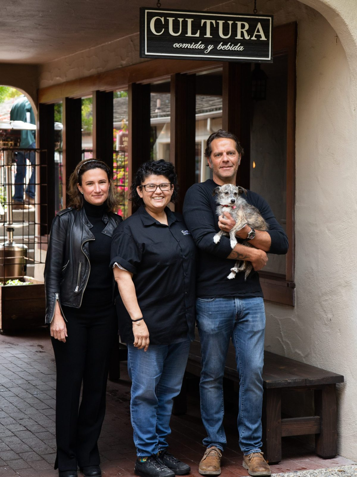 Managing partners, Sarah-Kabat Marcy and Michael Marcy with and Chef Michelle Estigoy, center, pose outside their restaurant Cultura Comida y Bebida in Carmel-By-The-Sea, on August 6, 2021. Photo by Carlos Rene Castro for CalMatters