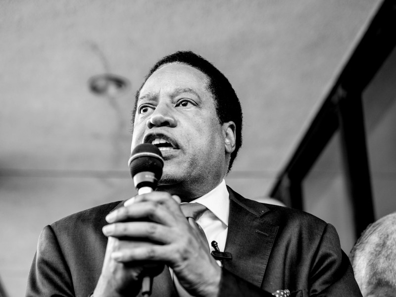 Conservative radio talk show host Larry Elder, a Republican recall candidate, talks to his supporters at a rally in Norwalk, on July 13, 2021. Photo by Pablo Unzueta for CalMatters