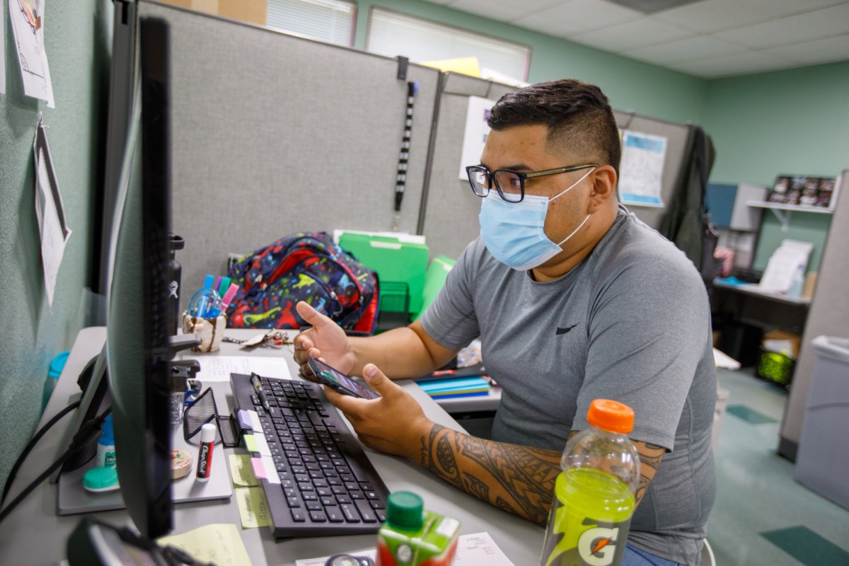 Employment coordinator assists client over phone