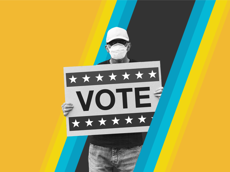 A man holds a sign that reads 'Vote'
