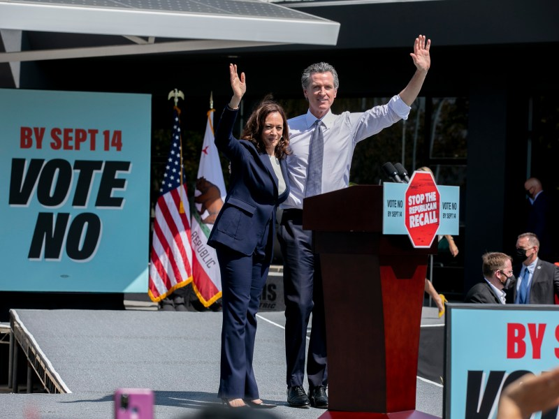 Vice President Kamala Harris and Gov. Gavin Newsom wave to the crowd during a campaign rally at the IBEW-NECA training center in San Leandro on Sept. 8, 2021. Newsom faces the recall election next week. Photo by Anne Wernikoff, CalMatters