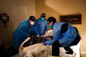 Emergency medical workers lift a patient onto a gurney in Placentia on Jan. 9, 2021. A summer coronavirus surge driven by the delta variant is again straining some hospitals particularly in rural areas of California, but the trend shows signs of moderating and experts say they expect improvement in coming weeks. Photo by Jae C. Hong, AP Photo