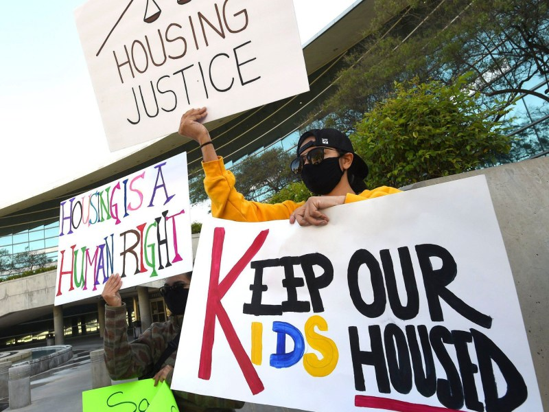 Demonstrators hold signs during a press conference at Fresno City Hall on April 8, 2021 held by the Right to Counsel coalition, which is seeking help on legal support and protection for renters. The California eviction moratorium ends after Thursday. Photo by John Walker, Fresno Bee