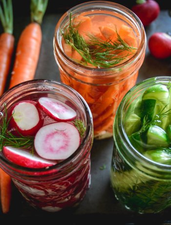Easy Fermented Vegetables in jars with radishes, cucumbers and carrots and dill