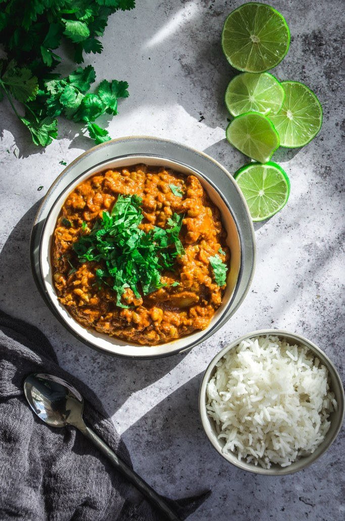 Easy and Healthy Cauliflower Mung Bean Curry on plate with rice and cilantro