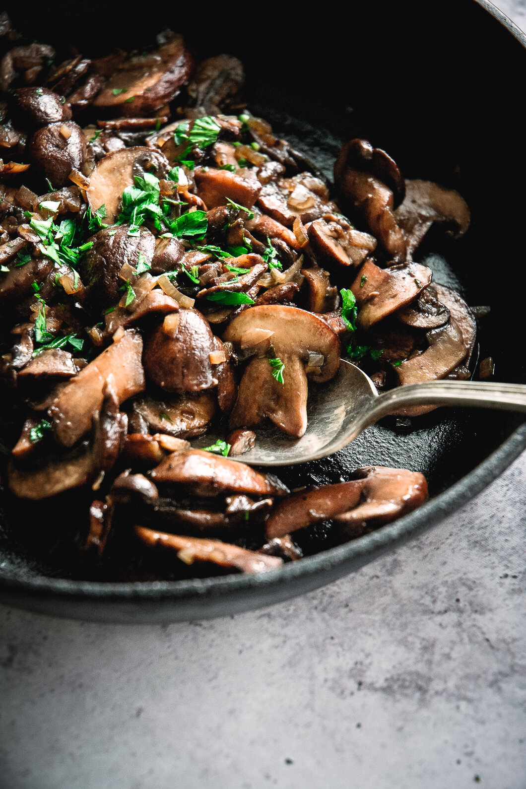 Sautéed mushrooms in pan with spoon