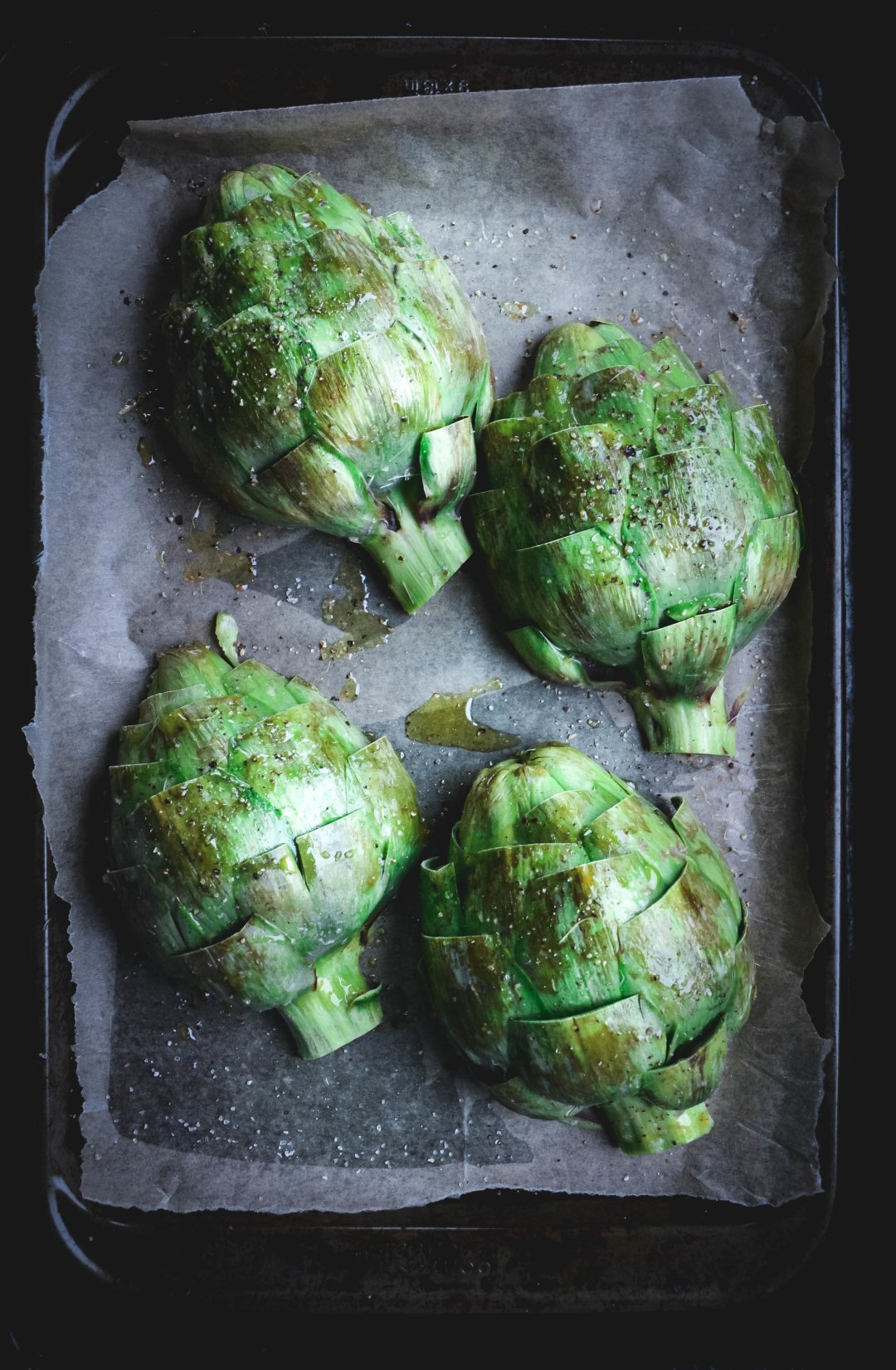 4 artichoke halves on roasting tray