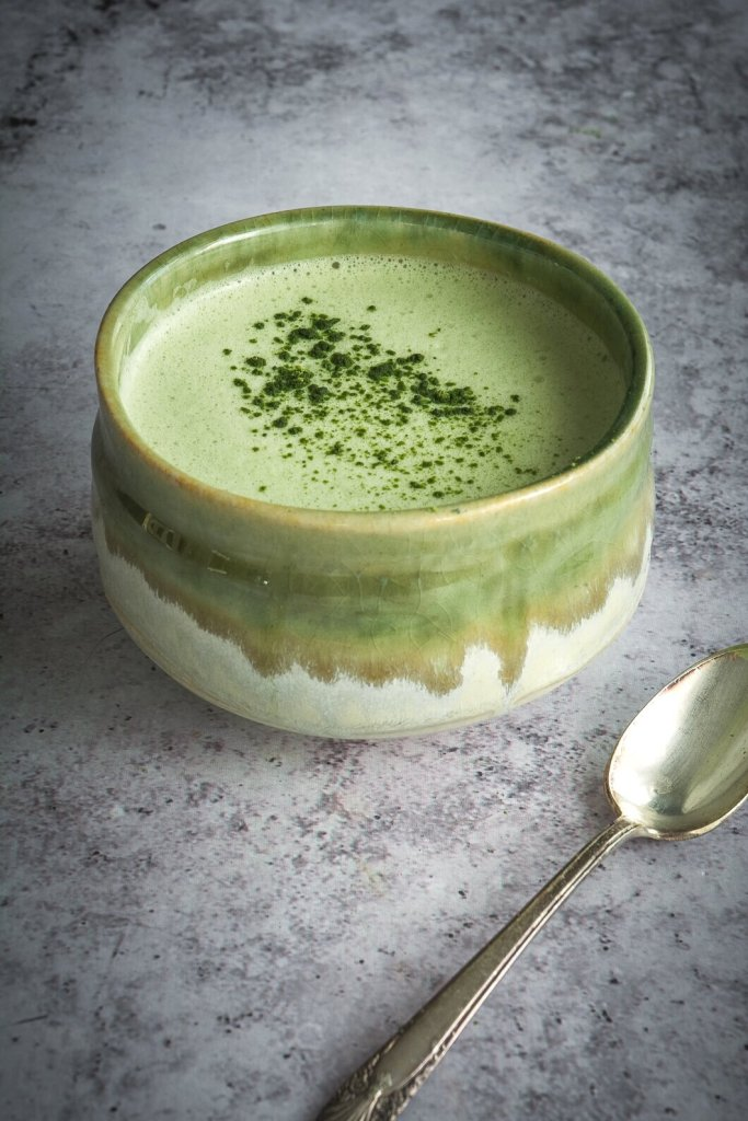 Matcha and Moringa Latte in green bowl with matcha in small bowl