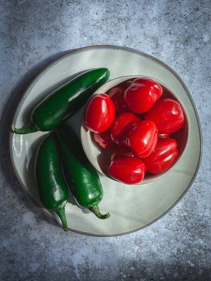 tomatoes and jalapenos on plate