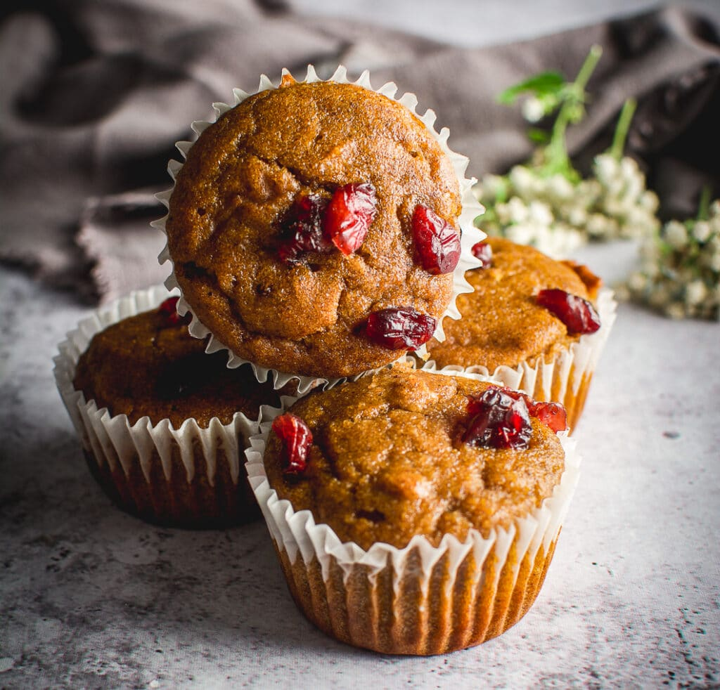 Healthy Grain-Free Cranberry Pumpkin Spice Muffins  on table