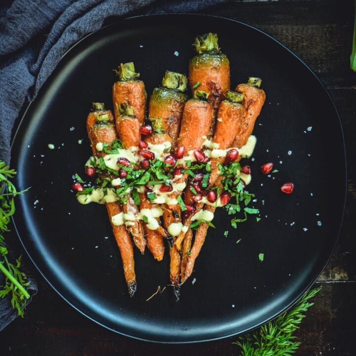 Roasted Carrots With A Simple Orange Tahini Sauce and Pomegranate