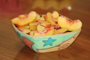 Nectarine slices in a colorful bowl - food presentation for CALMERme.com