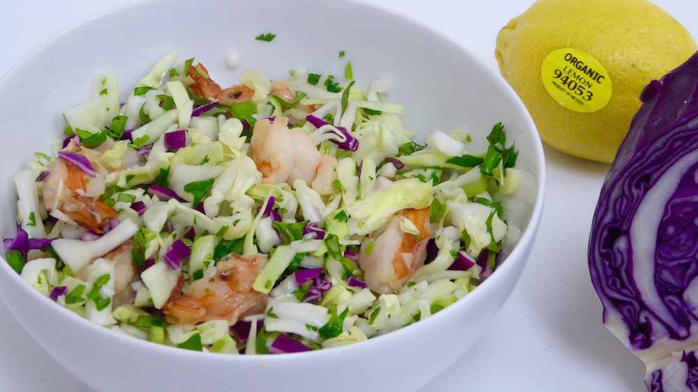 Image shows a dish of shredded cabbage salad with shrimp as described in this recipe on CALMERme.com