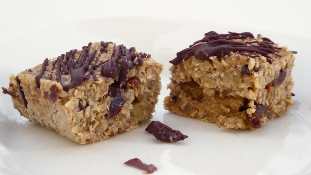 Image shows cherry walnut squares, as described in this recipe on CALMERme.com