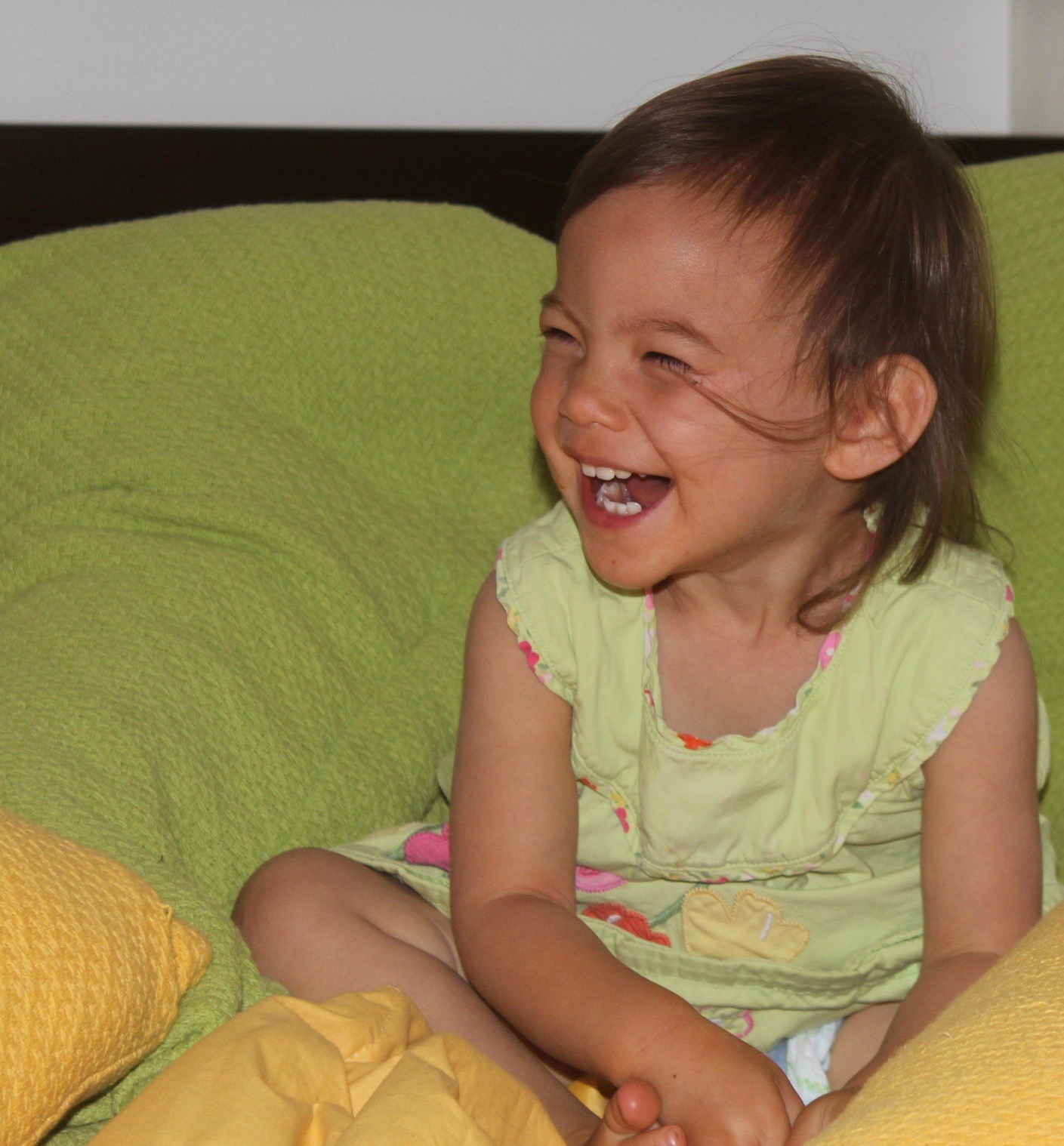 Image of little girl laughing to depict a gift of a laughter box from CALMERme.com