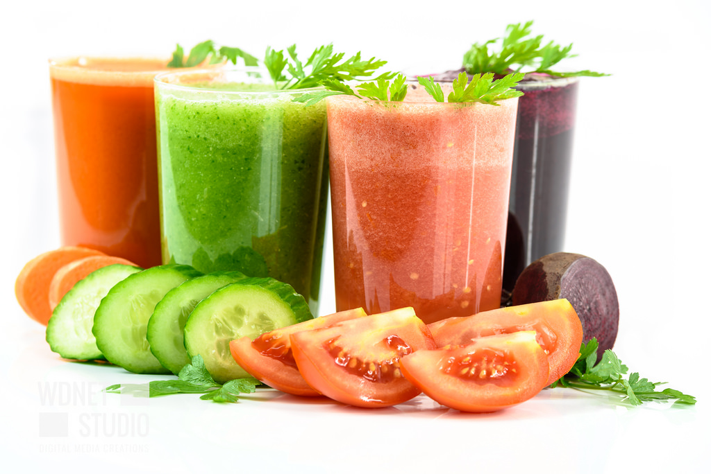 Image shows red, green, orange, and aubergine smoothies as described in this recipe post on CALMErme.com