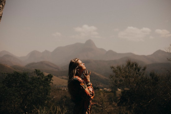 Woman in nature taking a peaceful moment. Real-Event OCD