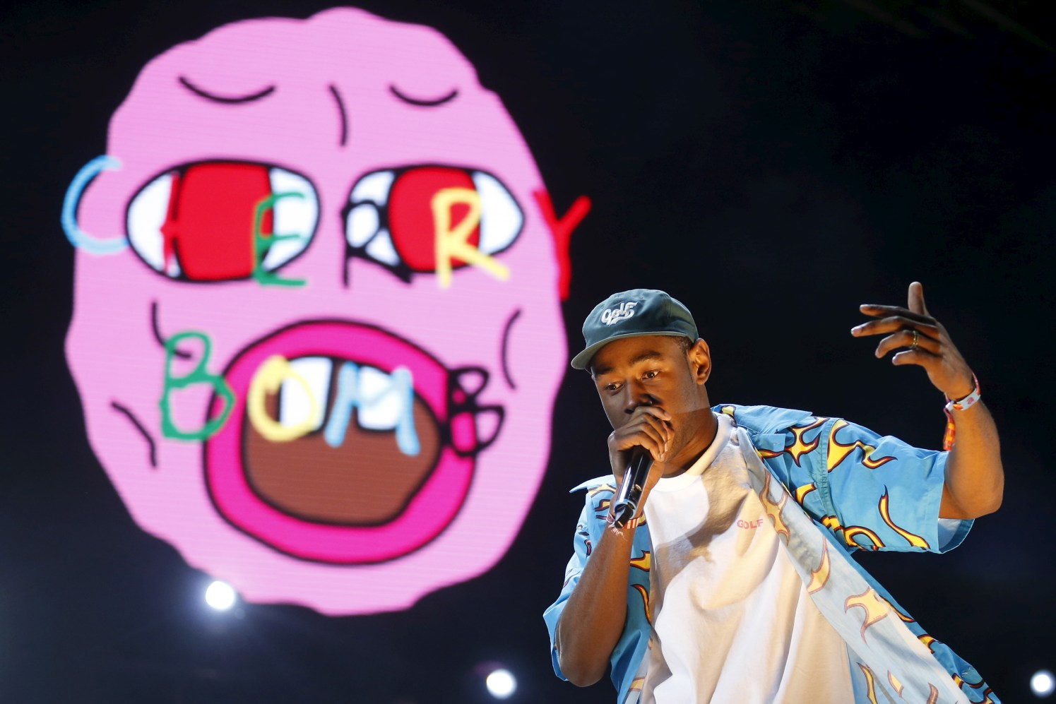Tyler the Creator performs on a stage set giant bed at the Coachella Valley Music and Arts Festival in Indio