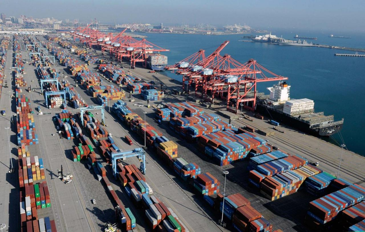 Containers and ships sit idle at the Port of Long Beach in this file photo