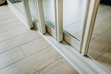 Close up of a vinyl sliding door on a white track