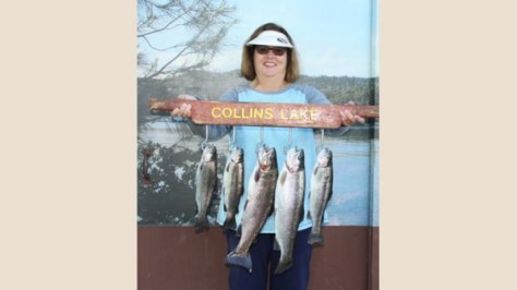 Sandy Settles and Ken Smith celebrate their Collins Lake catches.