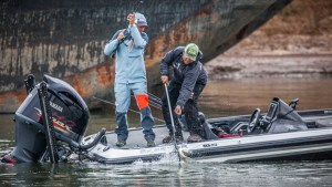 Kline (left) lands a bass during an FLW tournament, where he's won four events and was co-angler of the year in both 2013 and 2014. (COLIN MOORE/FLW)