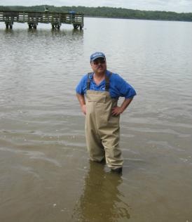 Man standing in water.