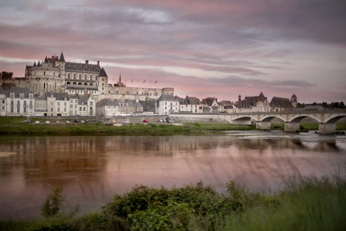 town of amboise on the loire river at sunset