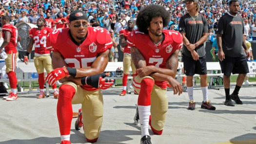 San Francisco 49ers' Colin Kaepernick (7) and Eric Reid (35) kneel during the national anthem before an NFL football game against the Carolina Panthers in Charlotte, N.C., Sunday, Sept. 18, 2016. (AP Photo/Mike McCarn)