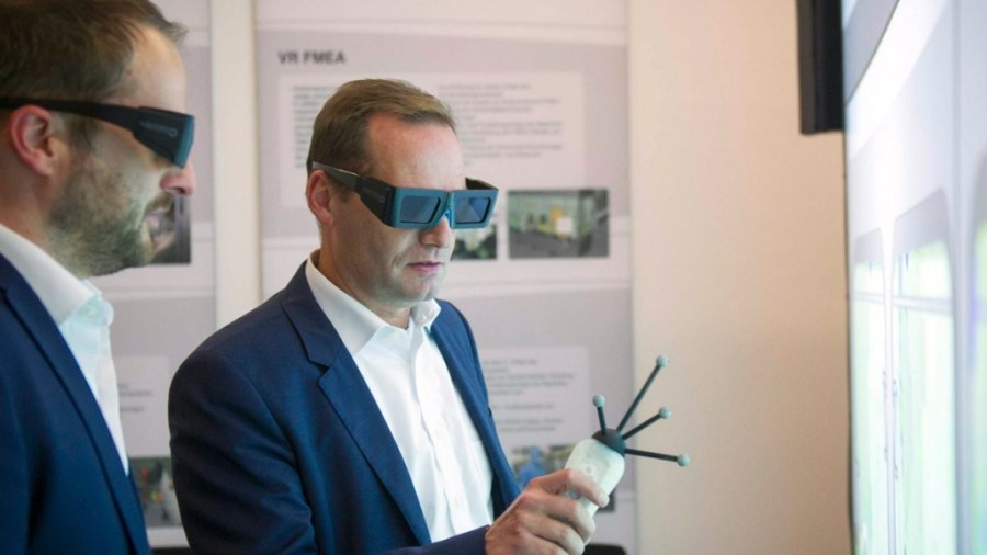 Executive using VR interface to Digital Twin