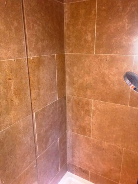 Etched Limestone Tiled Shower After Renovation Huntingdon