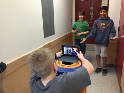Students creating content to demonstrate their learning.