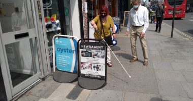 Mary and Robert and A-boards on Kentish Town road