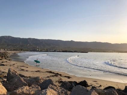 Surfers at sunrise Santa Barbara
