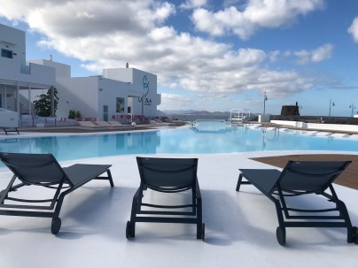 Pink beds & seating by the pool bar