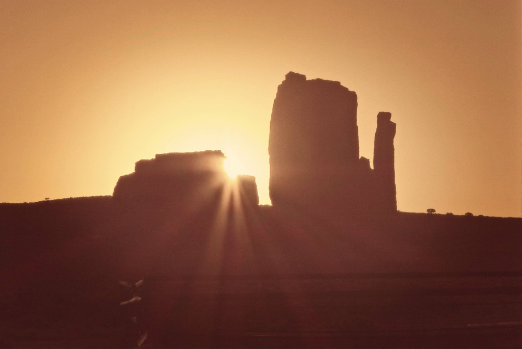 Sun rising over the monuments in Monument Valley
