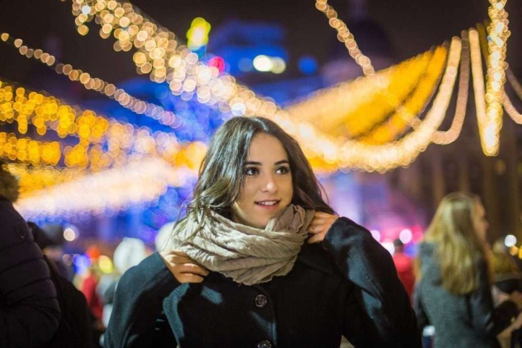 Portrait with Christmas Lights in the background - How To Photograph Christmas Lights Camera Jabber