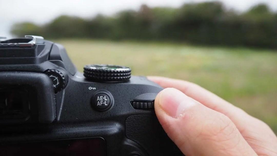 Nikon D3400 exposure compensation scroll wheel