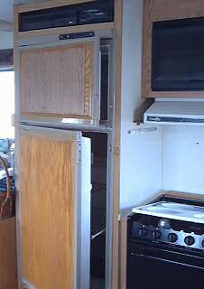 Old damaged refridgerator that will have to come out for replacement