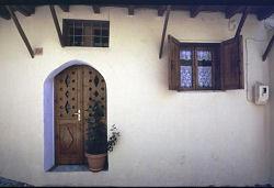 Cottage style door with small opening over the door, Rhodos, Greece, photograph by Brent VanFossen