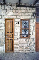 Tiny narrow wooden doorway, Rhodos, Greece, photograph by Brent VanFossen