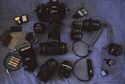 Take out your camera gear and really figure out what you will carry with you. Photo of camera gear by Brent VanFossen