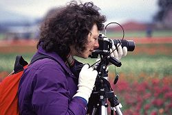 Deborah Kirsner photographs flowers on a tripod, photo by Lorelle VanFossen