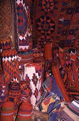 Brightly colored woven rugs and blankets, photo by Brent VanFossen
