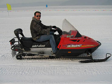 Alex takes a trip on a snow mobile in the snowy mountains of China